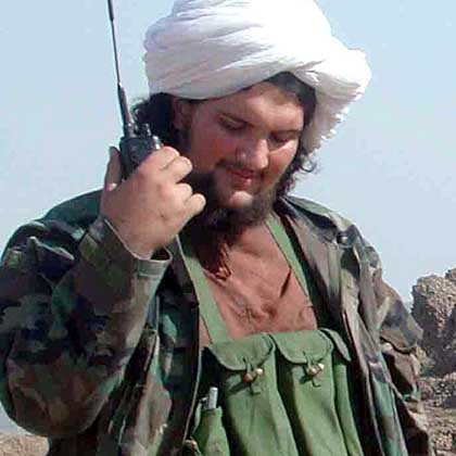 File photo of Mehsud, a former Guantanamo Bay inmate, talking on a radio at an undisclosed location in the tribal region near Afghan border