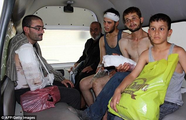 1407608244262_wps_11_Syrian_refugees_injured_d