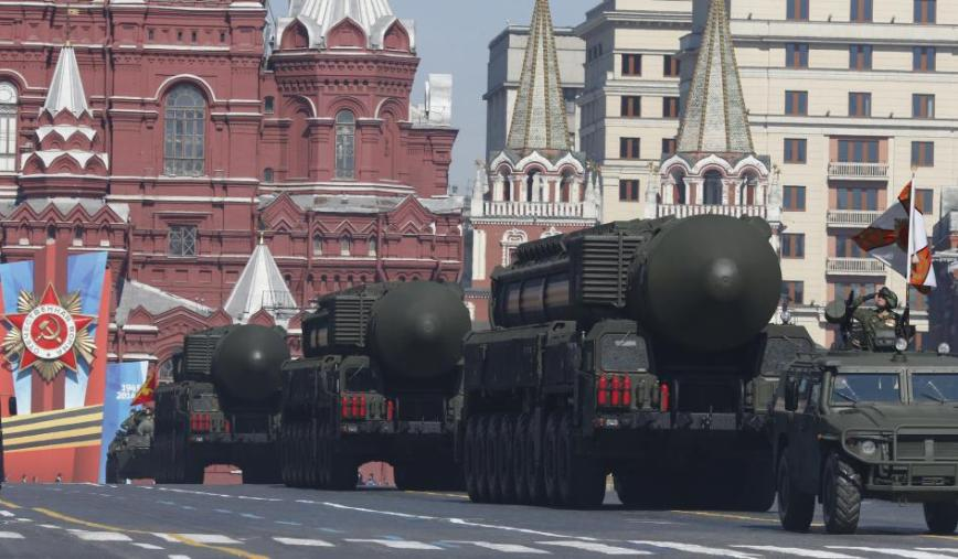 mobile Topol-M missile launching units drive in formation during the Victory Day parade in Moscow's Red Square May 9, 2014