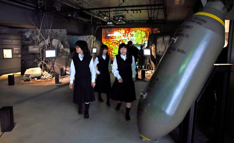 Students check out exhibits relating to U.S. air raids in Osaka Prefecture at the Osaka International Peace Center on April 30