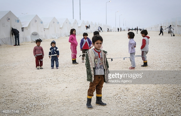 SANLIURFA, TURKEY - JANUARY 30 : Syrian kids fled from the civil war, living in Suruc refugee camp are seen in Sanliurfa, Turkey on January 30, 2015. Syrian kids will be able to continue their education with the Foreign Students Education Operation System in Turkey. (Photo by Orhan Cicek/Anadolu Agency/Getty Images)