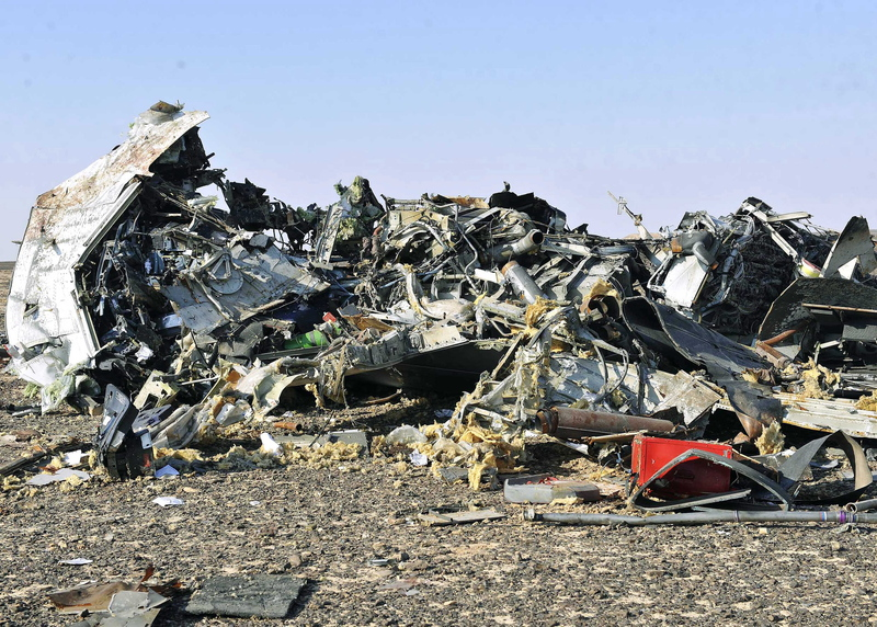 Debris from crashed Russian passenger jet lies strewn across the sand in Egypt's Sinai Peninsual on Saturday. EPA/STR
