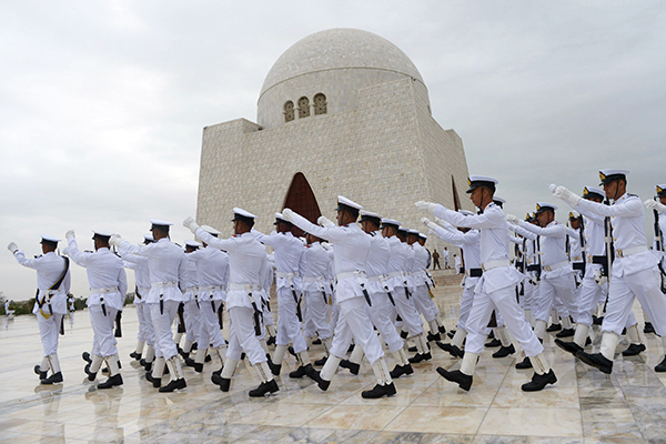 Pakistani Navy cadets march at the mausoleum of the founder of Pakistan Muhammad Ali Jinnah during a ceremony to mark the country's Independence Day in Karachi on August 14, 2014. Pakistan on August 14 celebrated the anniversary of the country's independence from British rule. AFP PHOTO/ Rizwan TABASSUM