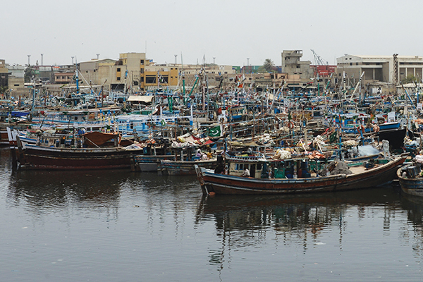 Fishing boats are moored near a naval dockyard in Pakistan's port city of Karachi on September 9, 2014. Taliban militants attacked a Karachi naval dockyard in a raid which left a Pakistani officer and two insurgents dead, officials said September 9. An officer and six sailors were also wounded in the attack early September 6 on the high security facility, a navy spokesman said, adding that four attackers had been captured alive. AFP PHOTO/ Asif HASSAN