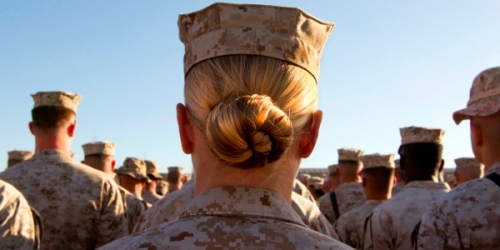 FILE - JANUARY 23, 2013: According to reports, Pentagon Chief Leon Panetta has removed the ban on women serving combat roles January 23, 2013 in Washington, D.C. The bans removal was reportedly recommended by the Joint Chiefs of Staff, overturning a 1994 rule keeping women out of ground combat units. . CAMP DELARAM, AFGHANISTAN - NOVEMBER 10:  (SPAIN OUT, FRANCE OUT, AFP OUT)  Sargent Crystal Groves US Marine with the FET (Female Engagement Team) 1st Battalion 8th Marines, Regimental Combat team II stands in formation during a ceremony for the 235th birthday of the Marines on November 10, 2010 at Camp Delaram in Helmand province, Afghanistan. There are 48 women presently working along the volatile front lines of the war in Afghanistan deployed as the second Female Engagement team participating in a more active role, gaining access where men can't. The women, many who volunteer for the 6.5 month deployment take a 10 week course at Camp Pendleton in California where they are trained for any possible situation, including learning Afghan customs and basic Pashtun language.  (Photo by Paula Bronstein/Getty Images)