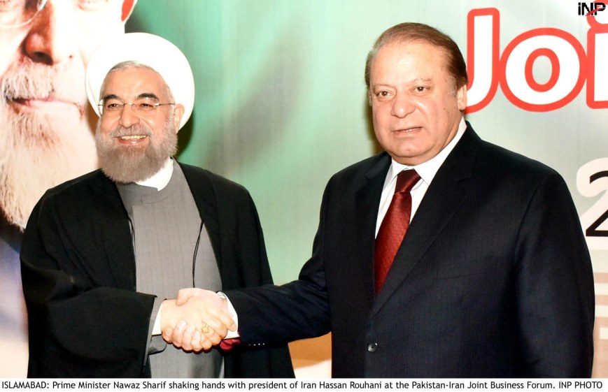 ISLAMABAD: Prime Minister Nawaz Sharif shaking hands with president of Iran Hassan Rouhani at the Pakistan-Iran Joint Business Forum. INP PHOTO