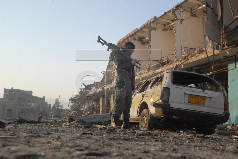 epaselect epa05626234 An Afghan soldier inspects the scene of multiple suicide bombing that targeted the German consulate in Mazar-e-Sharif, Afghanistan, 11 November 2016. At least four people including two suicide bombers were killed and dozens of injured when Taliban militants attacked the German consulate in Mazar-e-Sharif in Afghanistan.  EPA/MUTALIB SULTANI