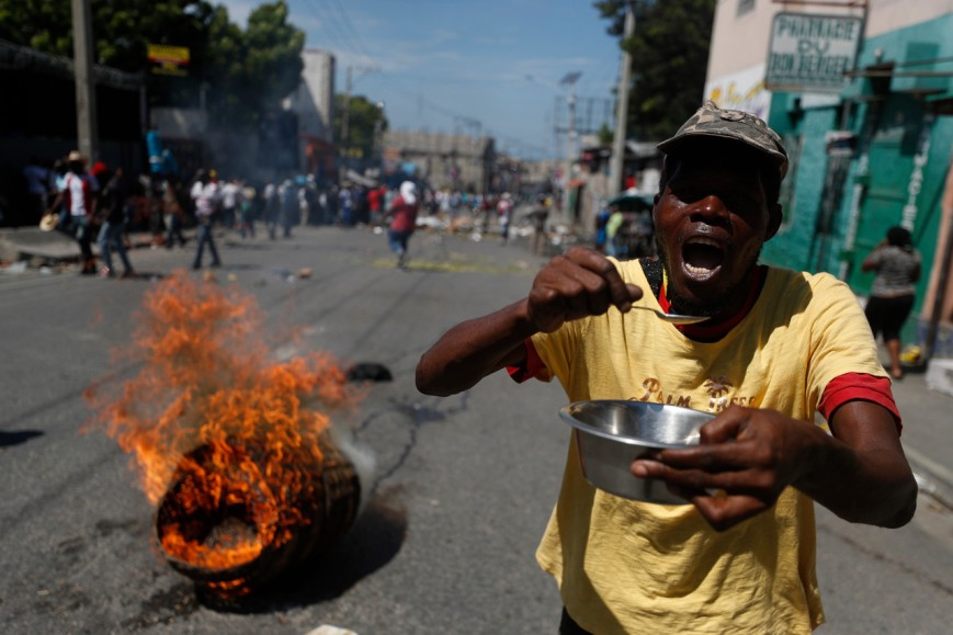 A demonstrator carries an empty bowl
